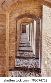 Isfahan, Iran - Brick arched passage inside the stone bridge Khaju.