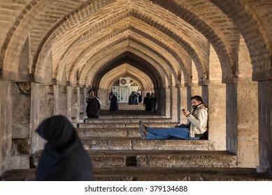 Isfahan, Iran - December 11, 2015: Pol-e Khaju bridge, across the Zayandeh River, in Isfahan, Iran.
