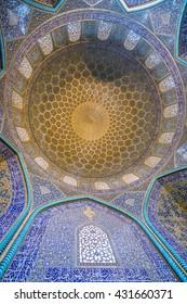 Isfahan, Iran - December 13, 2015: Sheikh Lotfollah Mosque at Naqhsh-e Jahan Square in Isfahan, Iran. Ceiling view