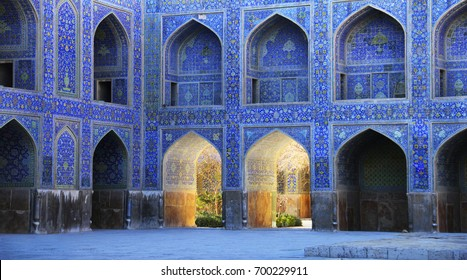 ISFAHAN, IRAN - JAN 08: Inner courtyard of Shah Mosque (Jaame' Abbasi or Imam Mosque), two rows of lancet arches with rich floral decoration on January 08, 2017 in Esfahan, Iran (Persia), Middle East