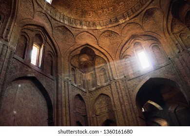 ISFAHAN, IRAN - JAN 8: Interior of ancient Jameh (Jame, Masjid) Mosque with rays of light from the window on January 8, 2019 in Esfahan, Iran. It has been a UNESCO World Heritage Site since 2012