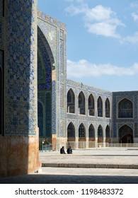 Isfahan, Iran - March 3, 2017 : two men sitting in the yard of Shah Mosque, also known as Imam Mosque. It is registered as a UNESCO World Heritage Site