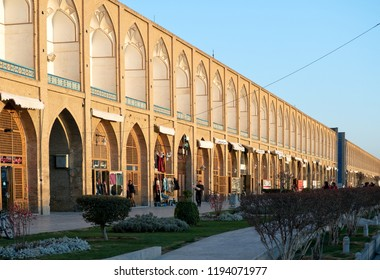Isfahan, Iran - March 4, 2017 : Souvenir shops in Naqsh-e Jahan Square at sunset. Also known as Meidan Emam, it is now a popular tourist attraction, and one of UNESCO's World Heritage Sites.