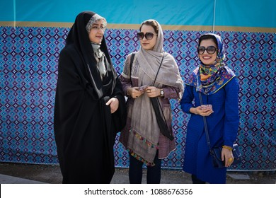 Isfahan, Iran - May, 2018: Group of young fashionable Iranian muslim women are standing on a main street