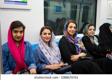 Isfahan, Iran - May, 2018: Group of young fashionable Iranian muslim women are riding new city's underground system