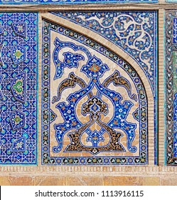 ISFAHAN, IRAN - MAY 8, 2015: Interior of the Taj al Molk Jameh mosque decorated with colorful tiles.