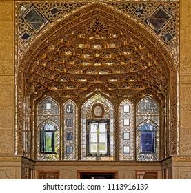 ISFAHAN, IRAN - MAY 8, 2015: Gilded tile muqarnas at Chehel Sotoon palace from 17th century.