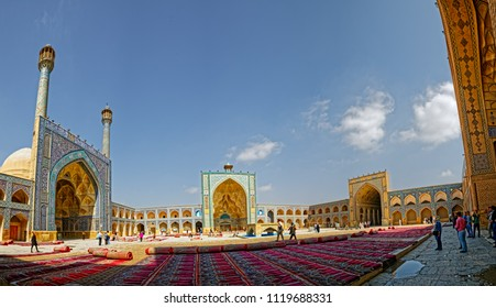 ISFAHAN, IRAN - MAY 8, 2015: Visitors at the inner courtyard where the sun drying cleaned praying carpets at the Jameh Mosque built in four iwan style.