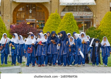 ISFAHAN, IRAN - MAY 9, 2015: Elementary school girls on a field trip in front of the Ali Qapu Palace on famous Imam square.