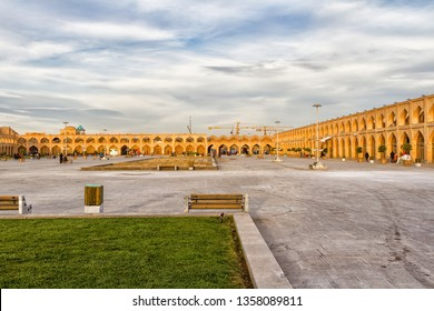 ISFAHAN, IRAN - NOV 21, 2016: Imam Ali (Atiq, Kohneh) Square with line of stores in historic complex around ita and the oldest city minaret of Imam Ali on the background, on November 21 in Isfahan