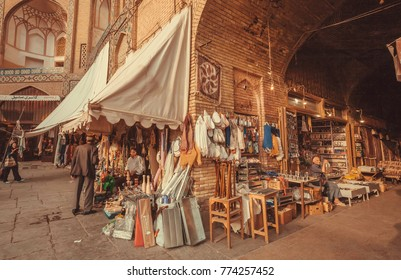 ISFAHAN, IRAN - OCT 14: Marketplace with sellers of good, stuff in walls of building of Eastern Bazaar on October 14, 2017. The 3rd largest city of Iran, Isfahan is example of Iranian Islamic culture