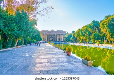 ISFAHAN, IRAN - OCTOBER 19, 2017: The way to  Chehel Sotoun Palace along lush garden and large pool, on October 19 in Isfahan