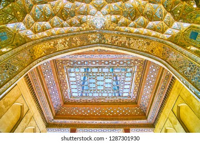 ISFAHAN, IRAN - OCTOBER 19, 2017: Chehel Sotoun Palace boasts amazing mirror work decorations on muqarnases and coffer ceilings, on October 19 in Isfahan