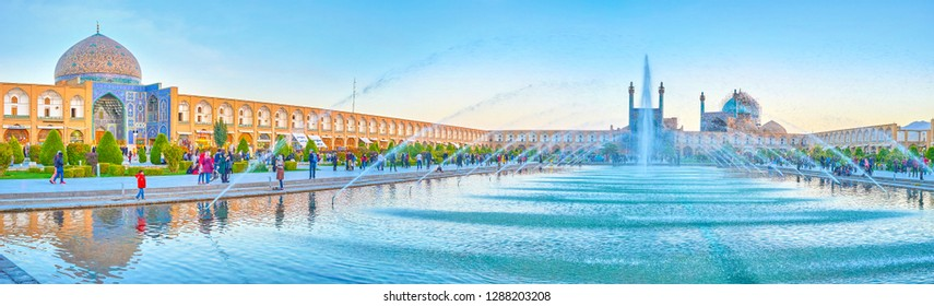 ISFAHAN, IRAN - OCTOBER 19, 2017: The panoramic view on the fountain in a pool andlandmarks of Nashq-e Jahad Sqaure, on October 19 in Isfahan