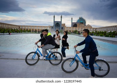 Isfahan, Iran - October, 2018: A group of beautiful young fashionable Iranian muslims are posing for photography in Naqsh-e Jahan Square in the centre of Esfahan