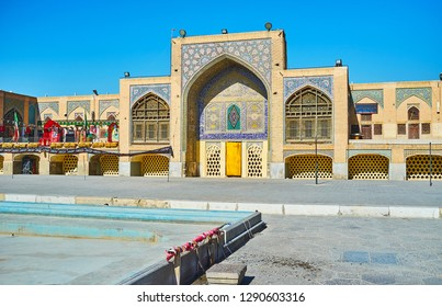 ISFAHAN, IRAN - OCTOBER 21, 2017: The scenic courtyard of Qajar Era Seyed Mosque, surrounded by two-storey building with four portals, decorated with intricate tiled patterns, on October 21 in Isfahan