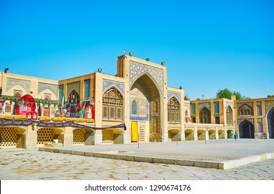 ISFAHAN, IRAN - OCTOBER 21, 2017: The ornate tiling is traditional element in Persian architecture, the court of Seyed Mosque is perfect example of decoration in Qajar Era, on October 21 in Isfahan.