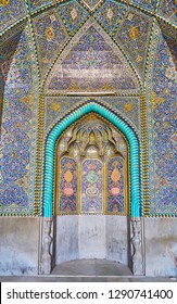 ISFAHAN, IRAN - OCTOBER 21, 2017: Seyed Mosque's mihrab is fine example of Qajar Era tile decor, including bright carved pieces, muqarnas shaped details and floral patterns, on October 21 in Isfahan.