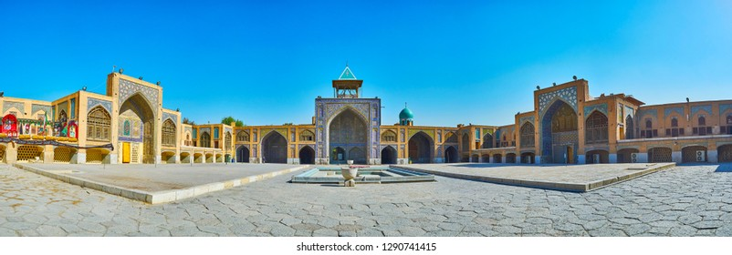 ISFAHAN, IRAN - OCTOBER 21, 2017: Panorama with three of four portals (iwans) of stunning Seyed Mosque, decorated with rich tile ornaments, Persian screens and arcades, on October 21 in Isfahan.