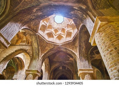 ISFAHAN, IRAN - OCTOBER 21, 2017: The light hole in carved dome of Northern shabestan of Jameh Mosque, on October 21 in Isfahan.