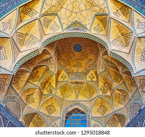 ISFAHAN, IRAN - OCTOBER 21, 2017: The ornate muqarnas semi-dome of the South portal (iwan) of Jameh mosque with fine brickwok and traditional Islamic patterns, on October 21 in Isfahan, Iran.