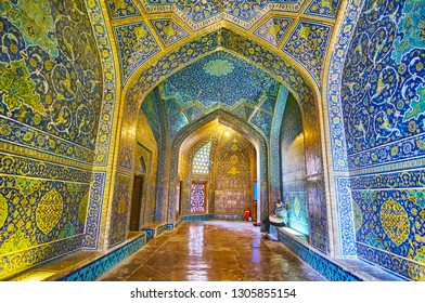 ISFAHAN, IRAN - OCTOBER 21, 2017: The narrow richly decorated vestibule of Sheikh Lotfollah mosque, decorated with traditional Persian tiling in bright blue gamma, on October 21 in Isfahan.