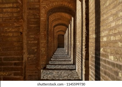 Isfahan, Iran - September 23, 2016: Ancient architecture of the bridge in Isfahan. Narrow brick corridor. Iran, Isfahan Province, Esfahan, Khajoo Bridge, Khaju. Heritage of ancient Persia.