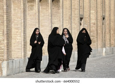 Isfahan,Iran - February 11,2008 : Women in Iran have to wear the burqa.In Iran, women typically dress in black.Iran women have to wear burqas.
