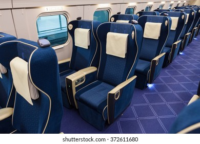 "ISHIKAWA , JAPAN - APRIL 6 : Green seats of E7 Series bullet train on April 6 , 2015 in Ishikawa, Japan. This train service as ""Kagayaki(Shine)"" for Hokuriku Shinkansen line (Tokyo - Kanazawa route)."