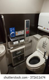 ISHIKAWA , JAPAN - APRIL 6 : high-tech toilets in E7 Series bullet train on April 6 , 2015 in Ishikawa, Japan. This toilets provide users a wide variety of functions.