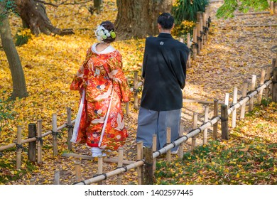 Ishikawa, Japan - November 2015: Couple in traditional dress walking in Kenroku-en Garden, Kanazawa, Ishikawa, Japan