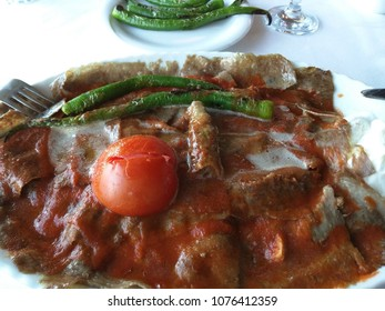 Iskender,  translated as Alexander (the Great)  Kebab is a well known ultra high caloric gourmet Turkish dish of Bursa made from high quality beef and typically enjoyed with yogurt and melted butter