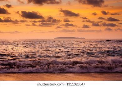 Isla de Cano in Costarican bay in sunset time