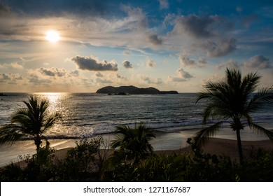 Isla Ixtapa, Mexico, Taken from Club Med Ixtapa, with beach, palm trees and cloudy sky