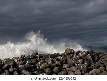 ISLA LOBOS, GALAPAGOS -OCT 23,2018 : the mighty waves of the Pacific Ocean crash on the rocks of Lobos Island, near San Cristobal, Galapagos, on October 23, 2018.