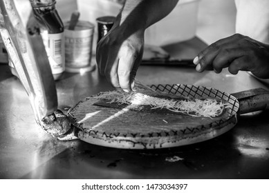 Isla Mujeres, Mexico - Apr 2017  Traditional Yucatan Marquesita is a crepe or waffle roll, which is pressed with a heavy iron grill, over an open fire, then filled with a grated cheese and chocolate