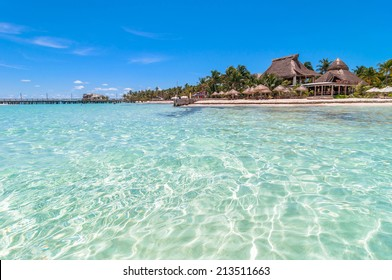 ISLA MUJERES, MEXICO - APRIL 22, 2014: tropical sea and coastline on famous Playa del Norte beach in Isla Mujeres, Mexico. The island is located 8 miles northeast of Canc�ºn in the Caribbean Sea