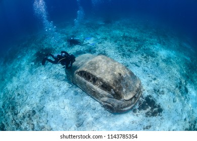 Isla Mujeres, Mexico - July 13, 2018: Underwater Museum of Isla Mujeres, Mexico, in Clear Blue Waters