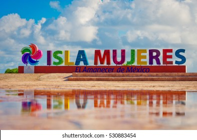 Isla Mujeres, Mexico - October 18, 2016 : Colorful inscription Isla Mujeres (Island of the Women) on caribbean sea coast, Mexico