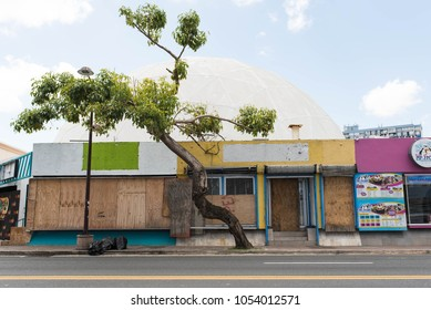 ISLA VERDE, PUERTO RICO - MARCH 16, 2018: Boarded up and closed down shop in Isla Verde area of San Juan, PR where businesses and people are still recovering from the hurricane.