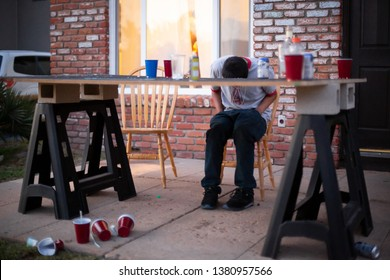 Isla Vista, California / USA - April 4 2014:  Student sleeping face down on a beer pong table after a day of drinking