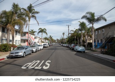 Isla Vista, California / USA - November 1, 2018:  View down Sabado Tarde Road, a residential street in the student town of Isla Vista, off campus from the University of California Santa Barbara (UCSB)
