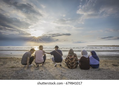 Islam happy people concept group of friends or volleyball team having fun on the beach.