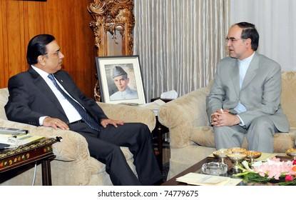 ISLAMABAD, PAKISTAN - APR 06: President, Asif Ali Zardari,  talks with Iran Ambassador, Mashallah Shakri during meeting at Aiwan-e-Sadr on April 06, 2011in Islamabad, Pakistan.