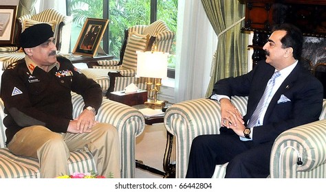 ISLAMABAD, PAKISTAN - DEC 02: Prime Minister, Syed Yousuf Raza Gilani, in meeting with Gen.Khalid Shamim Wynne, Chairman Joint Chiefs of the Staff Committee (JCSC), on December 02, 2010 in Islamabad, Pakistan.