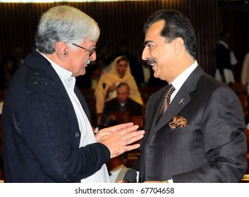 ISLAMABAD, PAKISTAN - DEC 22: Prime Minister, Syed Yousuf Raza Gillani, talks with Awami National Party Chief, Asfandyar Wali Khan on occasion of the National Assembly Session on December 22, 2010 in Islamabad, Pakistan.