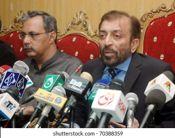 ISLAMABAD, PAKISTAN - FEB 02: Muttehda Qaumi Movement (MQM) Parliamentary leader in National Assembly, Dr.Farooq Sattar, addresses press conference on February 02, 2011in Islamabad.