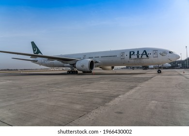 Islamabad, Pakistan, March 2021;  PIA, Pakistan International Airlines Boeing 777 parked on apron of Islamabad International Airport (ISB, OPIS)