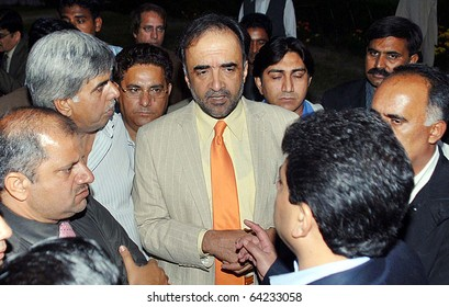 ISLAMABAD, PAKISTAN - NOV 01: Federal Minister for Information and Broadcasting, Qamar Zaman Kaira, talks with journalists at Parliament House on November 01, 2010 in Islamabad.
