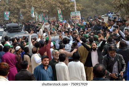 ISLAMABAD, PAKISTAN - NOV 07: Former Prime Minister, Nawaz Sharif passing through the road being welcoming by supporters and activists of PML-N on November 07, 2017 in Islamabad.